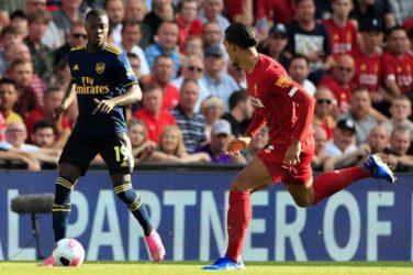 Nicolas Pepe (Arsenal) dribbling past Virgil Van Dijk (Liverpool)
