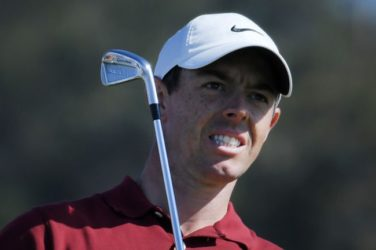 Rory McIlroy watches his shot
