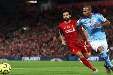 Fernandinho being tracked by Mo Salah